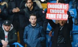 An Arsenal supporter makes his feelings about Arsène Wenger clear during the recent defeat at Chelsea. There was more fan unrest during the 5-1 loss to Bayern Munich