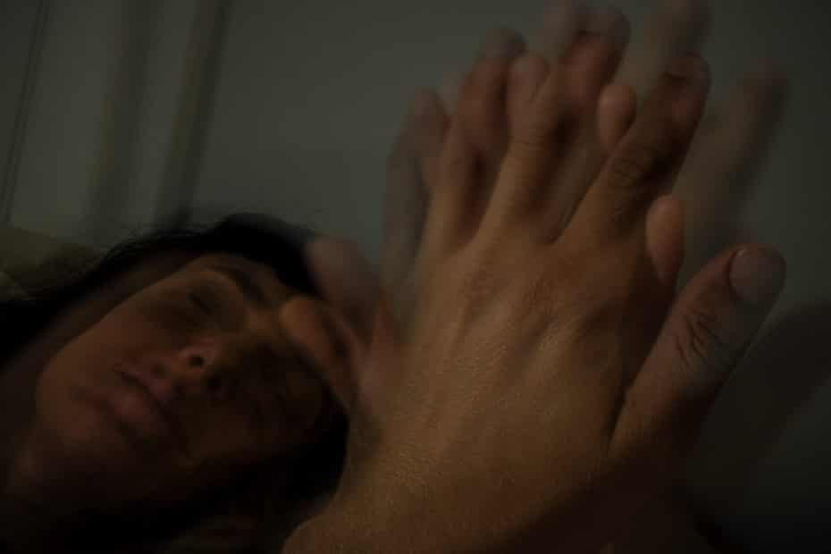 blurry image of hands and partner's face