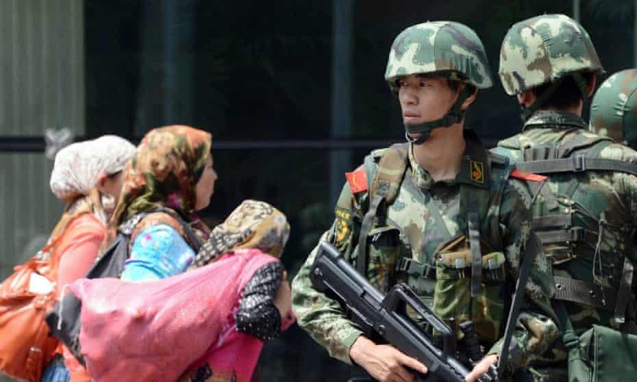 A paramilitary guard in Xinjiang capital Urumqi.