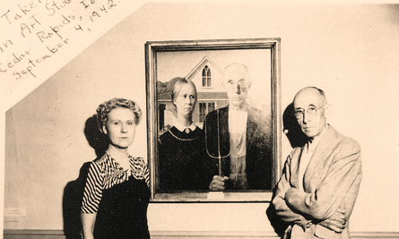 The artist's Models, Nan Wood Graham – his sister – and Byron McKeeby – his dentist – pose next to the painting.