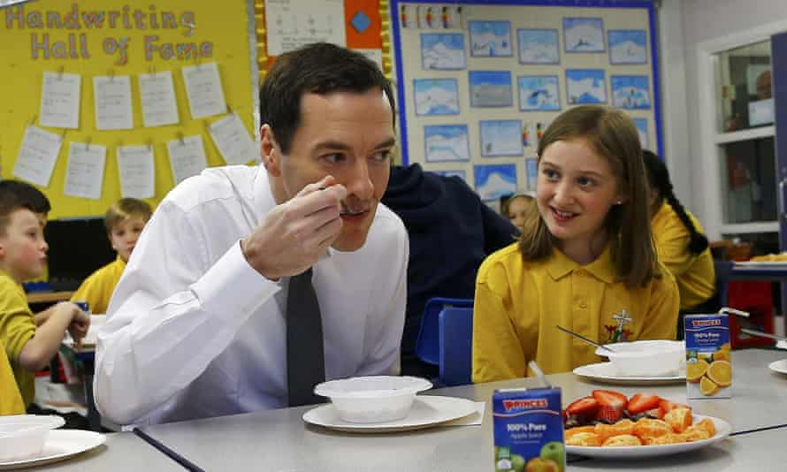 George Osborne visits a primary school the day after announcing in his budget speech that all schools in England will become academies by 2020.