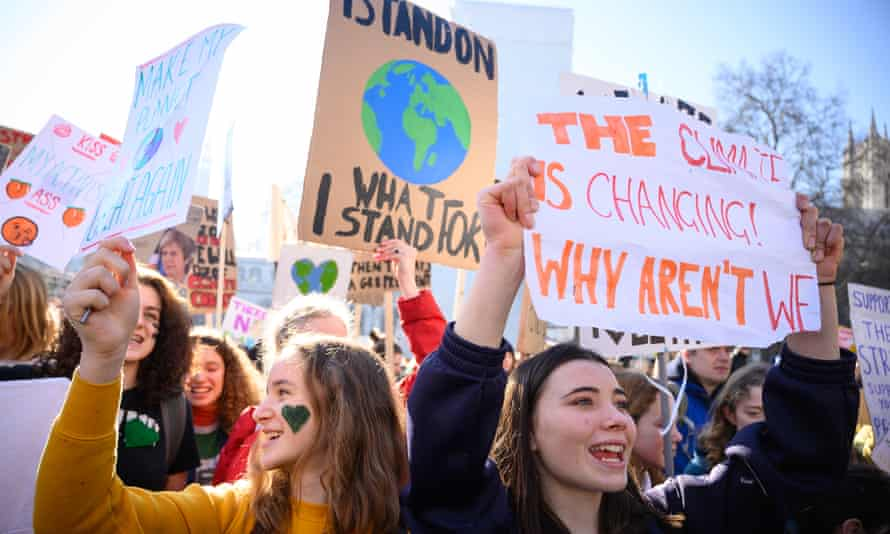 Students holds up their placards as they gather in Parliament Square during a climate protest on 15 February.