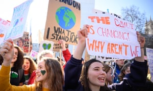 Young people take part in the climate strike in London.