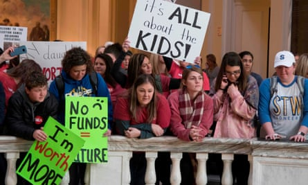 Teachers, students and supporters rally at the state capitol in Oklahoma City on 4 April.