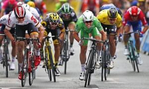 Mark Cavendish crosses the finish line ahead Germany's Andre Greipel and Peter Sagan.
