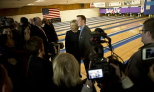Hillary Clinton poses for photos with Bryce Smith at a campaign event at Adel Family Fun Center.