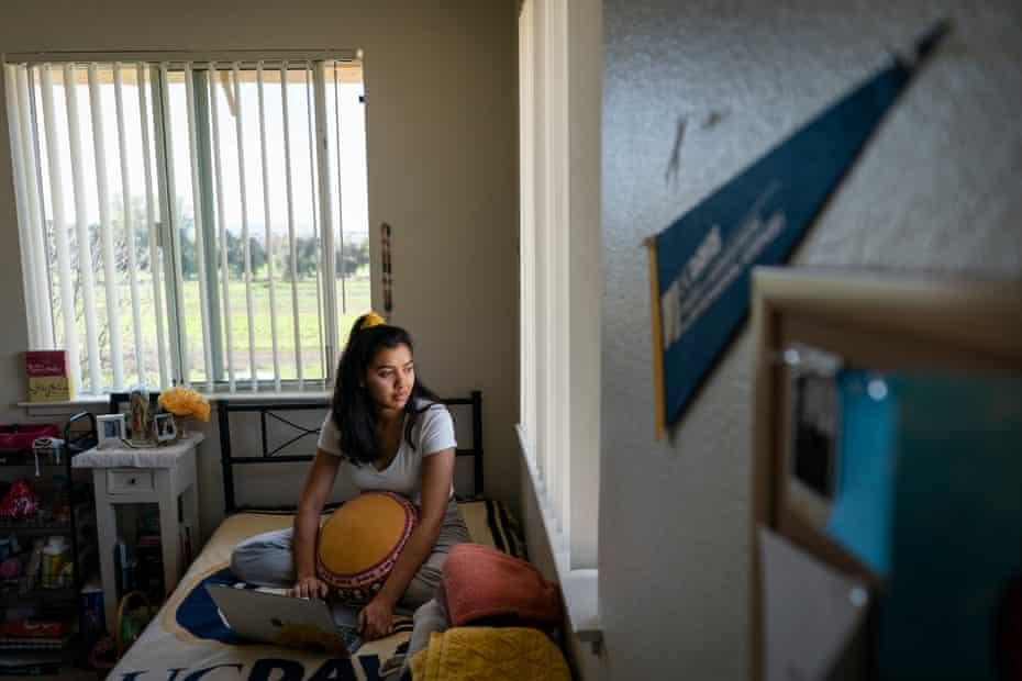 Karen sits on her bed in her room at UC Davis.