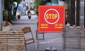 An alley is blocked with chairs and wood planks in Vung Tau, Vietnam.