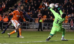 Christoffer Mafoumbi of Blackpool saves a shot from Alex Iwobi of Arsenal.