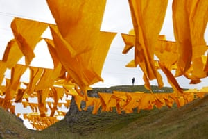 Saffron banners flutter in the wind