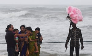A family take a selfie on a closed beach in Puri as cyclone Fani approaches the Indian coastline
