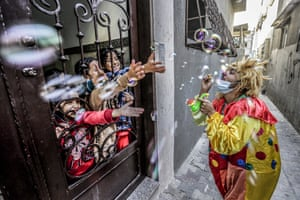 Gaza StripA clown entertains children at their home during a lockdown after the outbreak of the coronavirus in the Jabalia refugee camp
