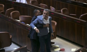 Jamal Zahalka, an Israeli Arab politician, is removed from the Knesset in protest