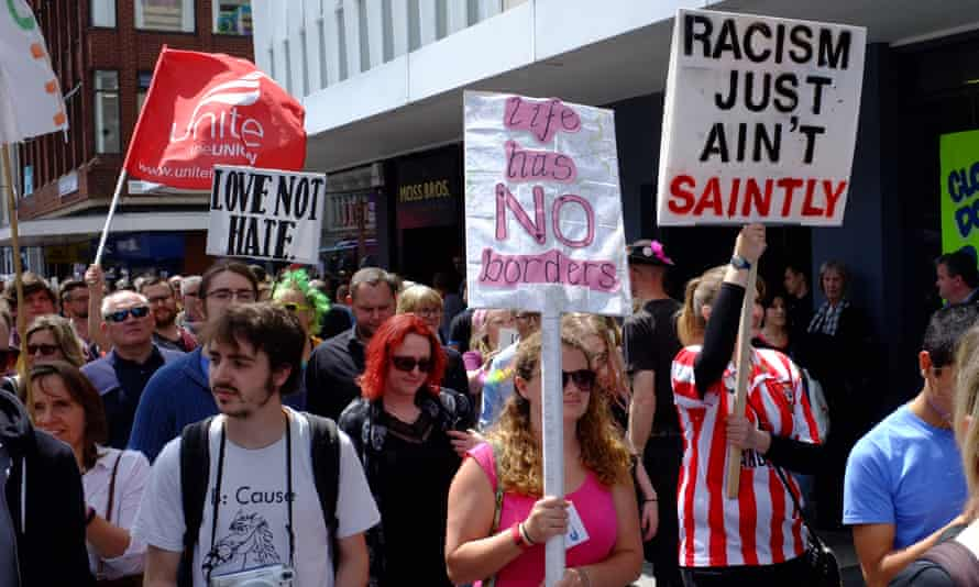 Demonstrators hold up anti-racism placards during a demonstration in Southampton.