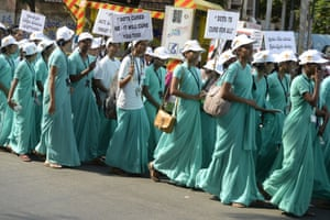 Nursing students take part in a rally for World Tuberculosis Day in Hyderabad, India