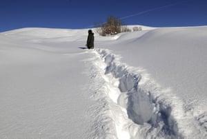 A villager walks through deep snow in Disbudak village of Bingol province in Turkey