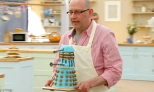 Great British Bake Off contestant Rob Smart with a Dalek cake.