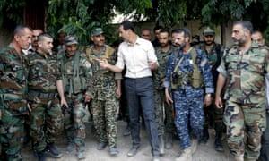 Bashar al-Assad visits Syrian army troops fighting near Damascus.