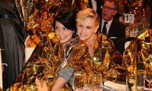 Nadezhda Tolokonnikova and  Charlize Theron don emergency blankets