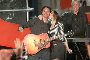 Madonna kisses Mirwais Ahmadzaï while showcasing songs from American Life in New York, 2003.