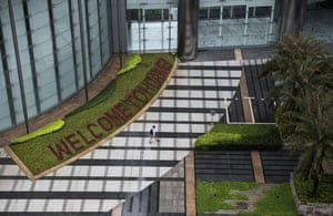 A garden with 'Welcome to Huawei' spelled out in flowers is seen outside an office building at the company's Bantian campus