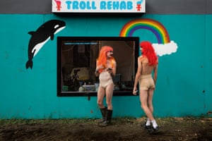 Harry Clayton-Wright and James Barnett as Trolls in front of the Troll Rehab centre, Shangri La field, Glastonbury Festival 2016