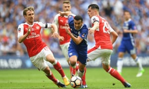 Pedro of Chelsea attempts to get past Nacho Monreal of Arsenal.