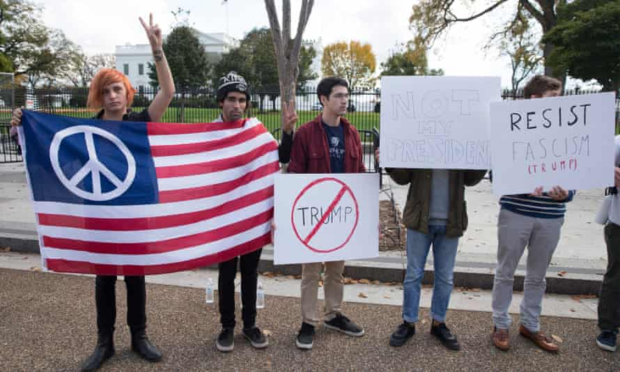 People outside the White House protest against Trump in Washington Wednesday.