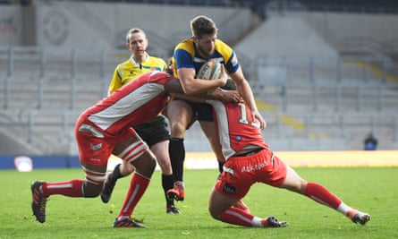 Coventry's Nile Dacres (left) and James Stokes tackle Yorkshire Carnegie's Ryan Shaw in one of this season's Championship games.