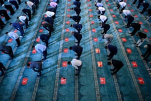 Russian Muslims gather in Moscow Cathedral Mosque during celebrations of Eid al-Adha
