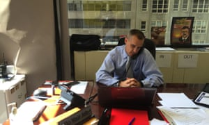 Corey Lewandowski, Donald Trump's campaign manager, speaks on the telephone while at his desk inside the Trump campaign headquarters located in Trump Tower in New York.