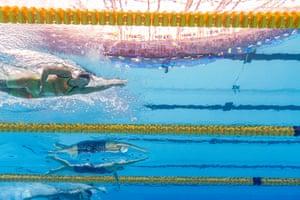Marlene Kahler of Austria and Han Da-kyung swimming