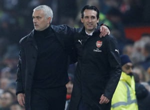 Jose Mourinho embraces Unai Emery after the match.
