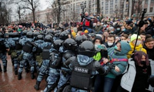 Law enforcement officers push protesters during a rally in support of Alexei Navalny in Moscow