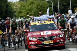 General director of the Tour de France, Christian Prudhomme, gestures to announce that the race is neutralised
