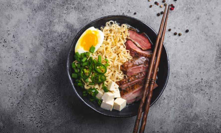 a bowl of Japanese ramen soup with meat, tofu and egg