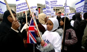 Muslim woman and children in London demonstrate againsti Islamophobia.