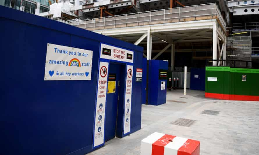 Safety signs and a thank you message to the NHS at a construction site in London