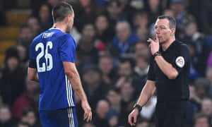 Kevin Friend prepares to show John Terry a red card for a foul on Peterborough's Lee Angol.