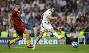 Gareth Bale drives in Real Madrid's second goal during their comfortable Champions League win against Roma.