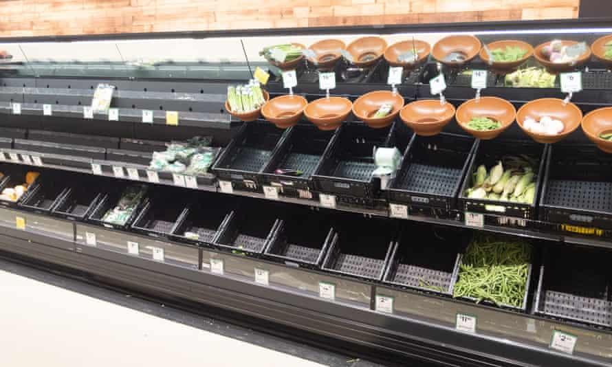 Empty fruit and vegetable shelves in an Australian supermarket