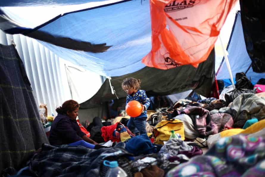 A child holds a ball at a camp near the San Ysidro checkpoint, after US border authorities allowed the first small group of women and children entry from Mexico overnight, in Tijuana, 1 May