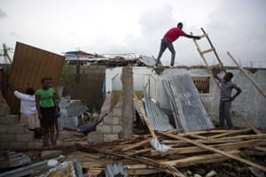 Residents repair their homes destroyed by Hurricane Matthew in Les Cayes.