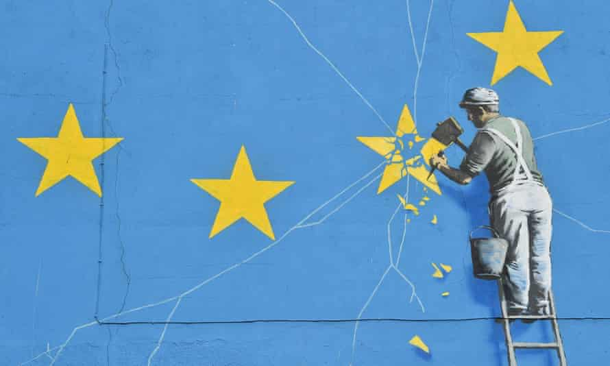 A mural by British artist Banksy depicting a worker chipping away at one of the stars on a European Union flag.
