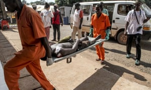 A wounded man is carried into the Bangui general hospital.