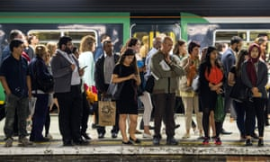 Passengers wait on the platform for a Southern Rail train.