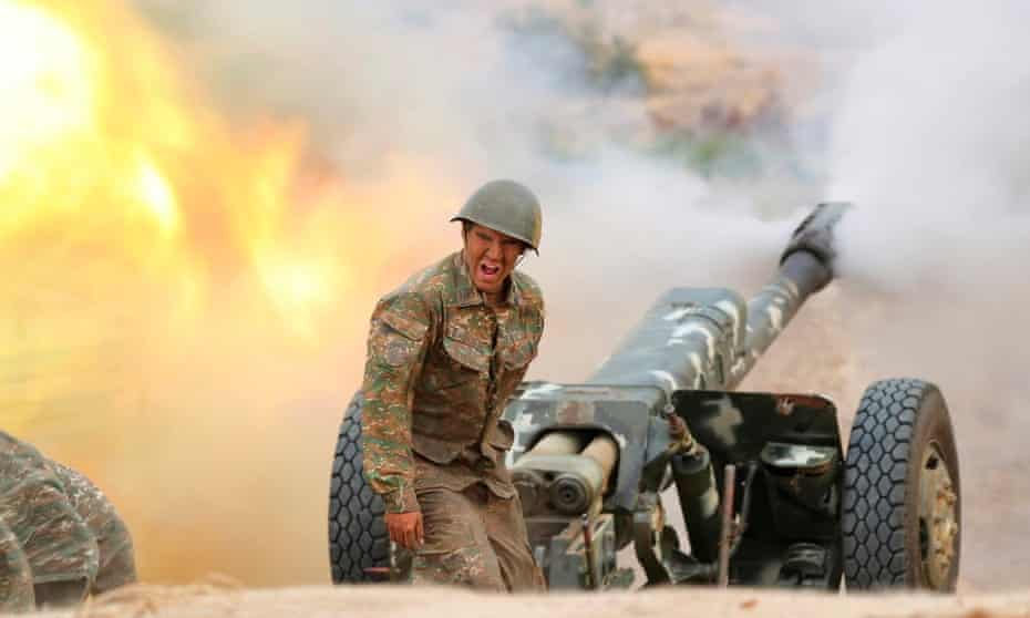 A soldier behind a anti aircraft gun in action