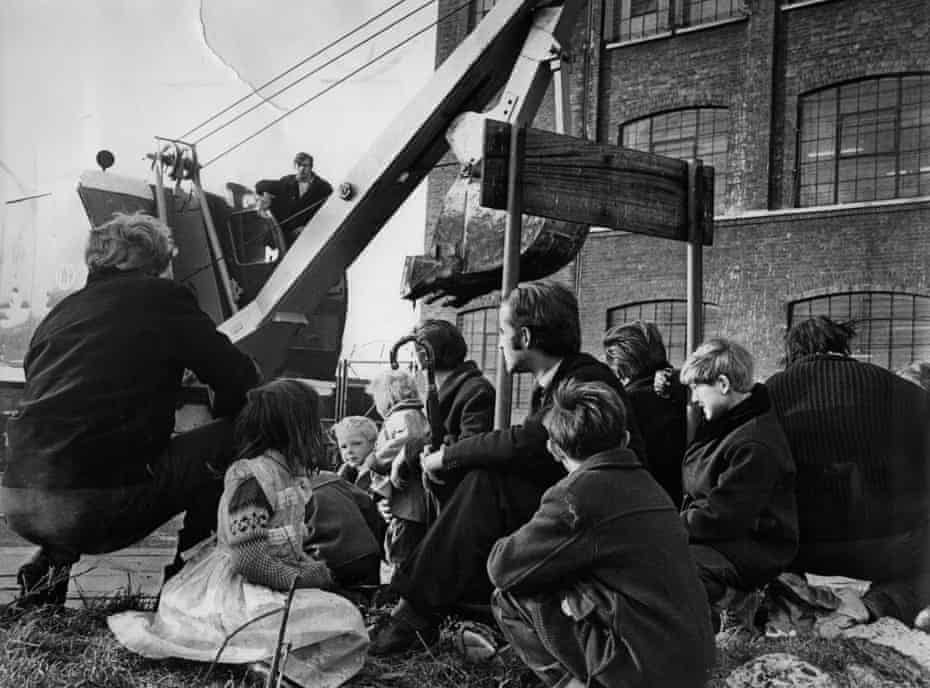 Gypsies and Travellers stand in the path of a digger as the council attempts to evict a site in Canning Town, east London in the 1960s.