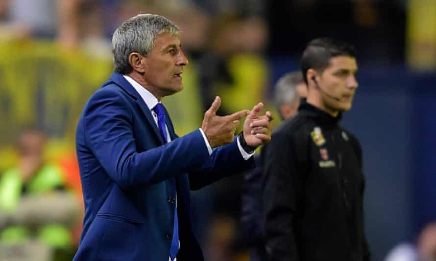 Las Palmas' coach Quique Setien gestures from the sideline.