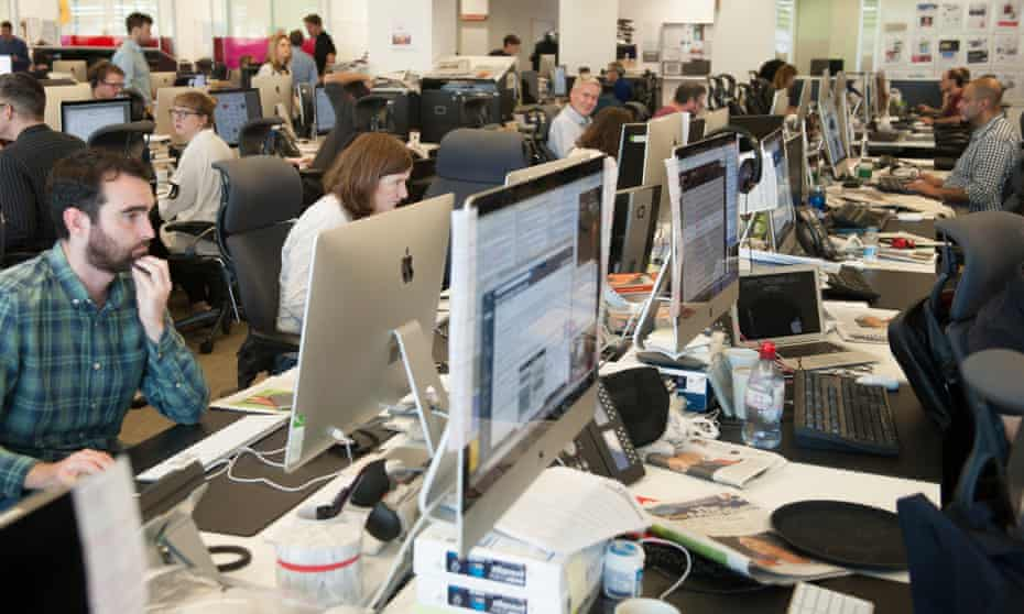 People working on computers in the Guardian newsroom